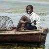 I det år, hvor Businge ikke gik i skole, fiskede han. Nu er det kun i weekenden, han tager ud og fisker. - Foto: Emmanuel Museruka
