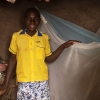 Nyirambere har myggenet over sin seng. Der er malaria-myg i området. - Foto: Emmanuel Museruka