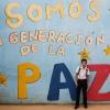 Vi er fredens generation, står der på muren ved Elkins skole - Foto: Andeas Beck
