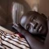 Rhoda i sin seng - læg mærke til myggenettet i baggrunden - foto: William Vest-Lillesøe