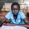 Samuel med sit skolehæfte - hans bedste fag er natur og teknologi, som de kalder Science i Sydsudan - foto: William Vest-Lillesøe